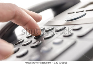 stock-photo-detail-of-using-a-telephone-keypad-shallow-dof-130439015
